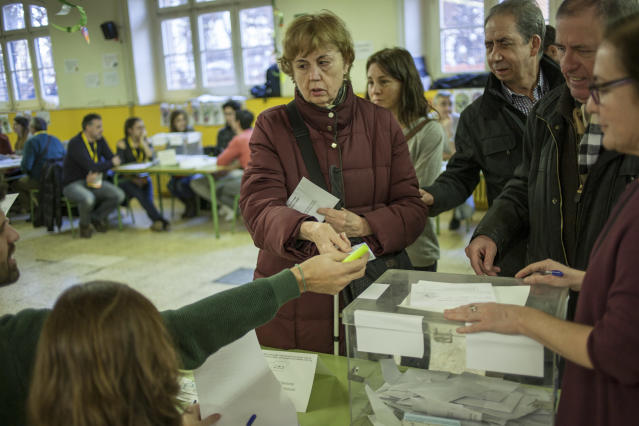 <p>A blind woman and other voters cast a ballot for the Catalan regional election at an elementary school in Barcelona, Spain, Dec. 21, 2017.<br>(Photograph by Jose Colon / MeMo for Yahoo News) </p>