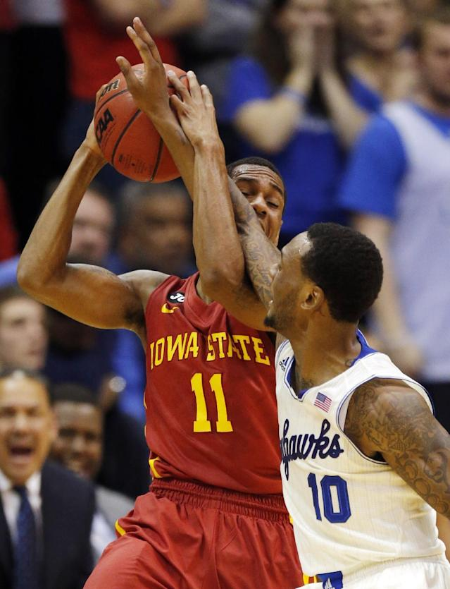 Iowa State guard Monte Morris (11) is fouled by Kansas guard Naadir Tharpe (10) during the first half of an NCAA college basketball game in Lawrence, Kan., Wednesday, Jan. 29, 2014. (AP Photo/Orlin Wagner)