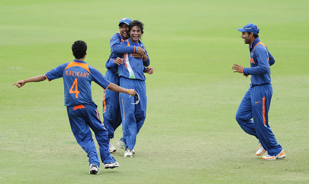 TOWNSVILLE, AUSTRALIA - AUGUST 20:   Kamal Passi (2nd right) of India celebrates with team mates after a Pakistan dismissal during the ICC U19 Cricket World Cup 2012 Quarter Final match between India and Pakistan at Tony Ireland Stadium on August 20, 2012 in Townsville, Australia.  (Photo by Ian Hitchcock-ICC/Getty Images)