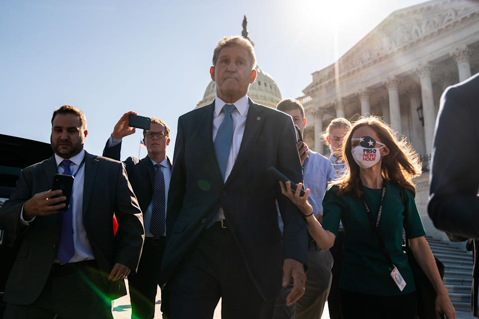 Sen. Joe Manchin, D-W.Va., surrounded by reporters outside the Capitol. (Kent Nishimura/Los Angeles Times via Getty Images)