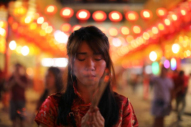 lunar new year praying incense