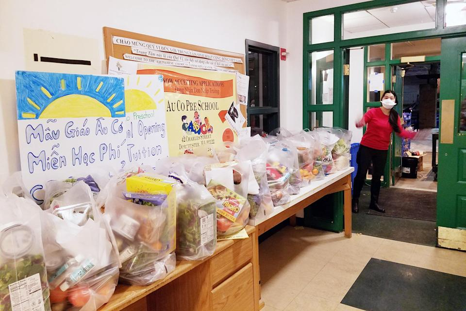 Image: VietAid, a Boston nonprofit, distributes free groceries and meals to the Vietnamese community. (Amy Yee)