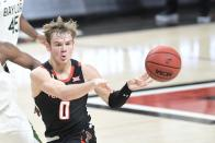 Texas Tech's Mac McClung (0) passes the ball during the second half of an NCAA college basketball game against Baylor in Lubbock, Texas, Saturday, Jan. 16, 2021. (AP Photo/Justin Rex)