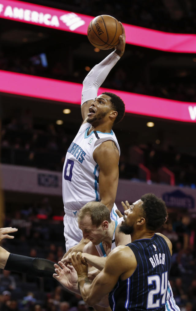 Charlotte Hornets forward Miles Bridges drives the lane to dunk against the Orlando Magic in the first half of an NBA basketball game in Charlotte, N.C., Monday, Jan. 20, 2020. (AP Photo/Nell Redmond)