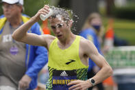 CJ Albertson, of Fresno, Calif., pours water on his head while running in the 125th Boston Marathon, Monday, Oct. 11, 2021, in Newton, Mass. (AP Photo/Steven Senne)