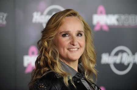 FILE PHOTO: Singer Melissa Etheridge poses for photographers after receiving a star on the Hollywood Walk of Fame in Los Angeles September 27, 2011. REUTERS/Phil McCarten/File Photo