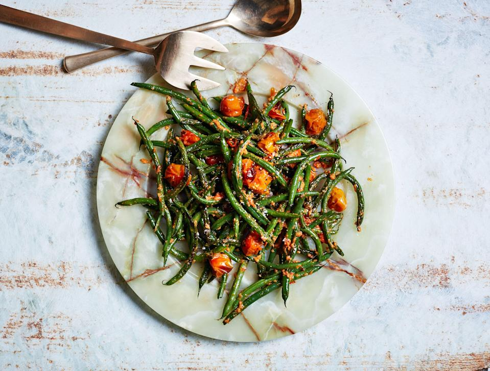 "This kicky sauce, inspired by Spanish romesco, uses cherry tomatoes. <a href=""https://www.bonappetit.com/recipe/blistered-green-beans-with-tomato-almond-pesto?mbid=synd_yahoo_rss"" rel=""nofollow noopener"" target=""_blank"" data-ylk=""slk:See recipe."" class=""link rapid-noclick-resp"">See recipe.</a>"