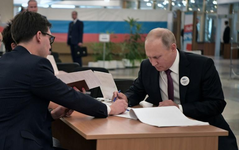 Putin (R) had endorsed the ruling party's candidate in the vote