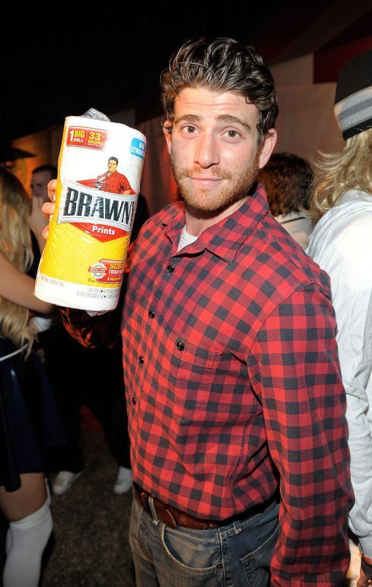 <p>Walk around with a roll of paper towels and everyone at the party will instantly love you — especially if their wine takes a spill. To match the Brawny man (or woman), wear a red plaid shirt and look as suave as possible. </p>