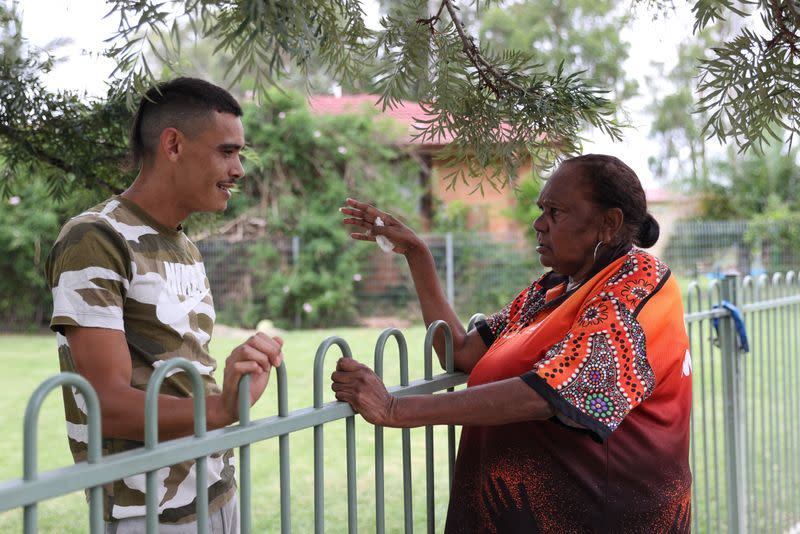 Indigenous Muruwari elder Rita Wright speaks with her nephew in Sydney