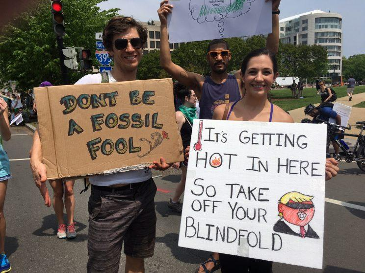Protesters carry signs during the Peoples Climate March at the White House in Washington. (Photo: Ben Adler for Yahoo News)