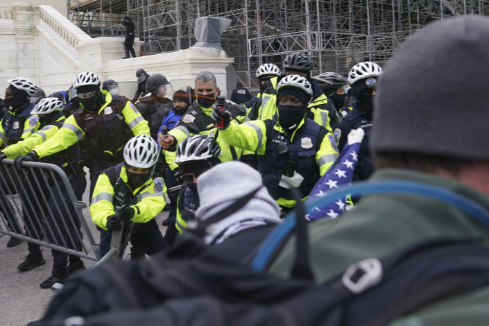 In this Wednesday, Jan. 6, 2021, photo, violent rioters try to break through a police line on the West Front of the Capitol, in Washington. The top watchdog for the U.S. Capitol Police will testify to Congress for the first time about the department's broad failures before and during the Jan. 6 insurrection. Among them was missed intelligence and old weapons that officers didn't feel comfortable using. (AP Photo/John Minchillo)