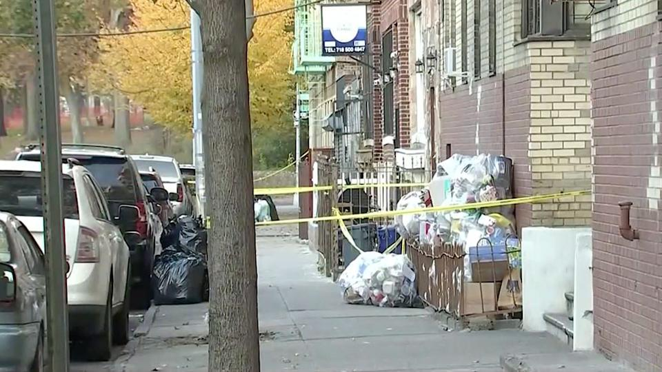 The area outside the building in the Bronx where the babies were found is seen to be blocked off with police tape