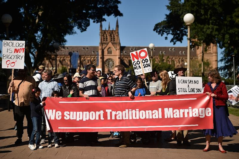 Although attitudes to same-sex marriage vary across denominations and congregations, from the pulpit and among the pews, many Australians view the church as the greatest source of resistance to such unions (AFP Photo/Peter PARKS)