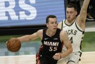 Miami Heat's Duncan Robinson drives past Milwaukee Bucks' Pat Connaughton during the first half of an NBA basketball game Saturday, May 15, 2021, in Milwaukee. (AP Photo/Morry Gash)