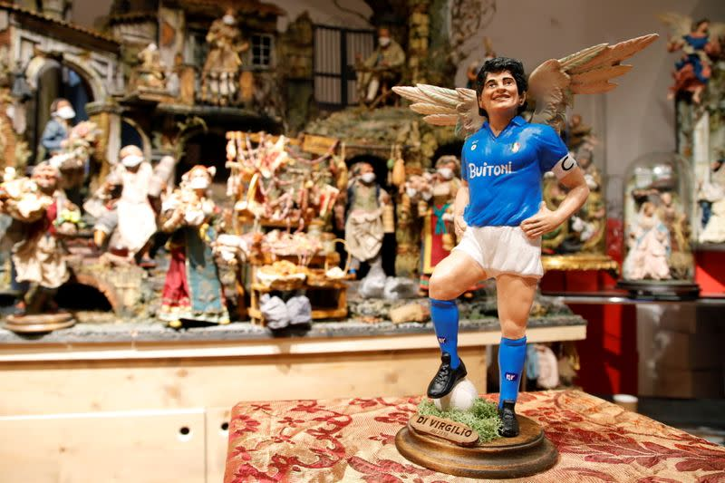 People mourn the death of Argentine soccer legend Diego Maradona in Naples