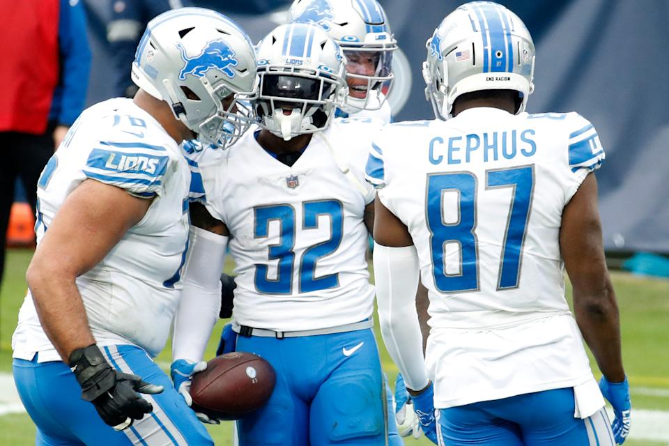 Running back D'Andre Swift (32) of the Detroit Lions celebrates with teammates after rushing for a touchdown over the Tennessee Titans during the second quarter of the game  at Nissan Stadium on Dec. 20, 2020 in Nashville, Tennessee.