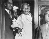 GANDHI LEAVES FOR LANCASHIRE | Gandhi at Euston station before his trip to Lancashire where he visited the cotton industry. (Photo by Hulton-Deutsch/Hulton-Deutsch Collection/Corbis via Getty Images)