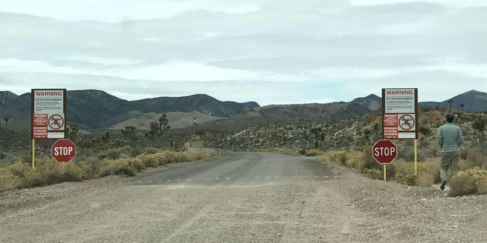 """<p>Area 51 is famously surrounded by <a href=""""https://www.pinterest.co.uk/pin/363102788680123092/?lp=true"""">menacing warning signs</a>. The place is not just a Hollywood myth: It is a genuine classified defense site and is protected as such.</p><p>""""Restricted Area: it is unlawful to enter this area without permission of the Installation Commander""""</p><p>Legally speaking, if you cross that line you are committing an offense against Section 1382 of Title 18, of entering a military installation without permission, which makes you liable to a $500 fine. But that's the least of your worries.</p><p>""""While on this installation all personnel and the property under their control are subject to search""""</p><p>This is not an idle threat. Being caught in Area 51 means you are likely to be searched rather thoroughly and be left lying face down on the ground for three hours, as happened to a <a href=""""https://www.dailymail.co.uk/news/article-2216077/BBC-film-crew-held-gunpoint-trying-failing-sneak-U-S-Area-51-military-base.html"""">BBC film crew</a> in 2016.</p><p>In 2019 a <a href=""""https://www.nnss.gov/docs/docs_newsreleases/2019/NR-19-0001_Incident%20at%20NNSS%20012819.pdf"""">man was shot dead</a> after failing to stop at a security gate. After an 8-mile chase, the man was stopped by NNSS Security Protective Force Officers and Nye County Sheriff's Office and shot when he refused to follow verbal instructions and did not drop a 'cylindrical metal object.' </p><p>They will shoot if they need to.<br></p>"""