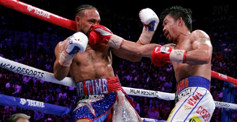 Filipino boxer Manny Pacquiao slams a right to the face of Keith Thurman during their WBA super world welterweight title fight