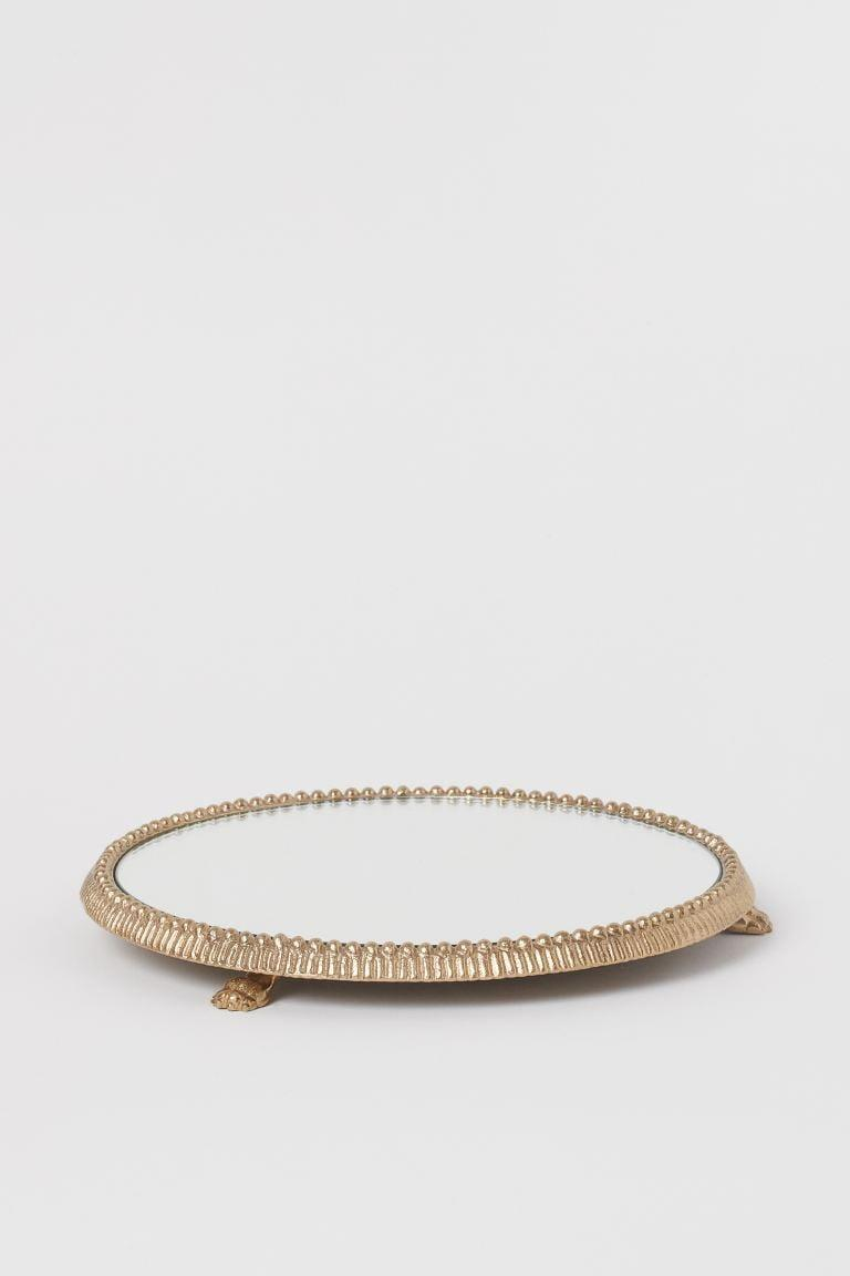 <p>The details on this <span>H&amp;M Mirrored Tray</span> ($30) make it look double the price.</p>