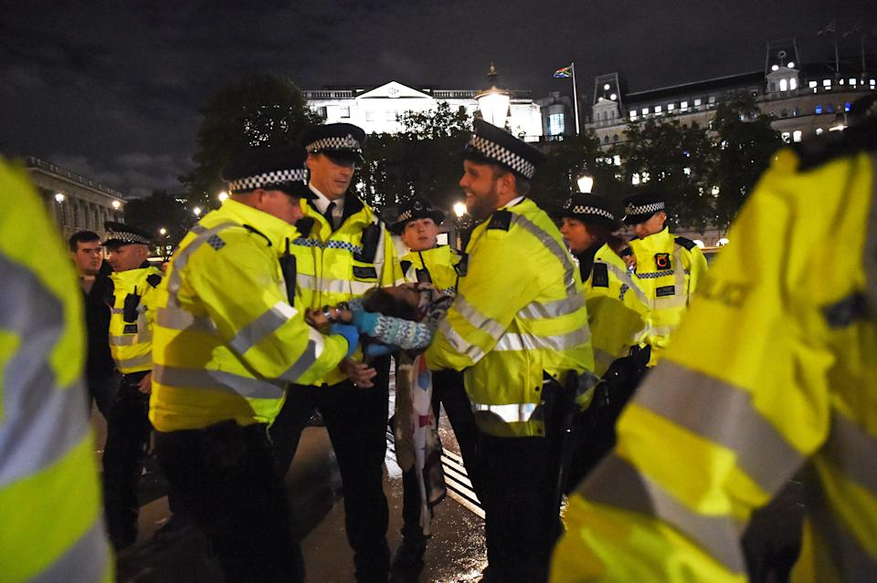 Police remove an Extinction Rebellion protester from Trafalgar Square in central London. (Photo by David Mirzoeff/PA Images via Getty Images)