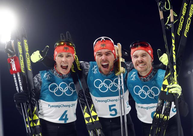 Nordic Combined Events - Pyeongchang 2018 Winter Olympics - Men's Individual 10 km Final - Alpensia Cross-Country Skiing Centre - Pyeongchang, South Korea - February 20, 2018 - Eric Frenzel of Germany, Johannes Rydzek of Germany and Fabian Riessle of Germany celebrate after crossing the finish line. REUTERS/Kai Pfaffenbach