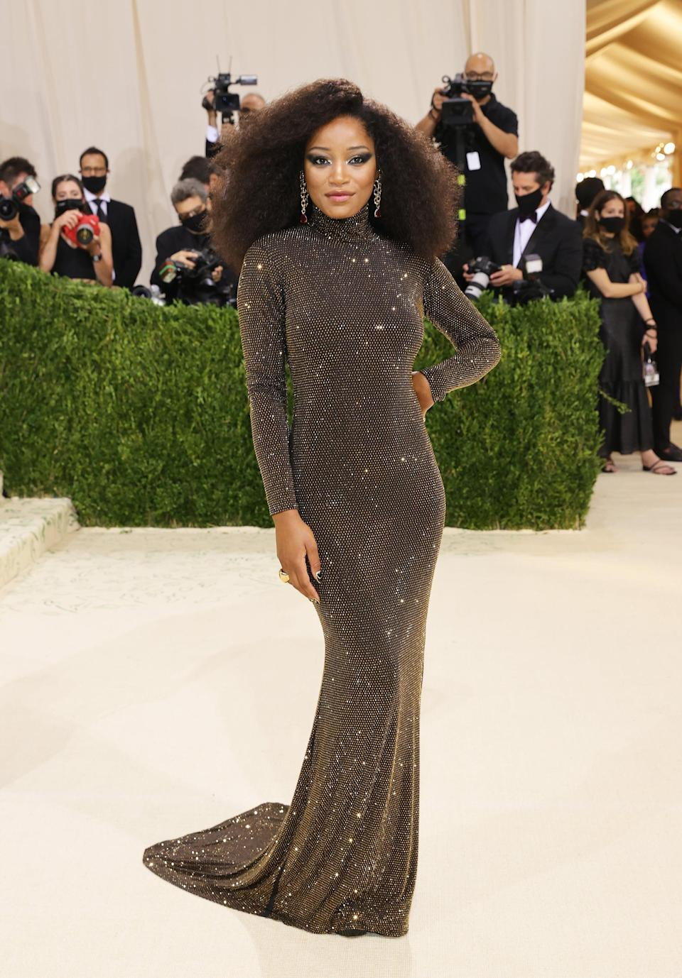 <p>Keke Palmer wore a backless, metallic, crystal-encrusted gown by Sergio Hudson.</p>