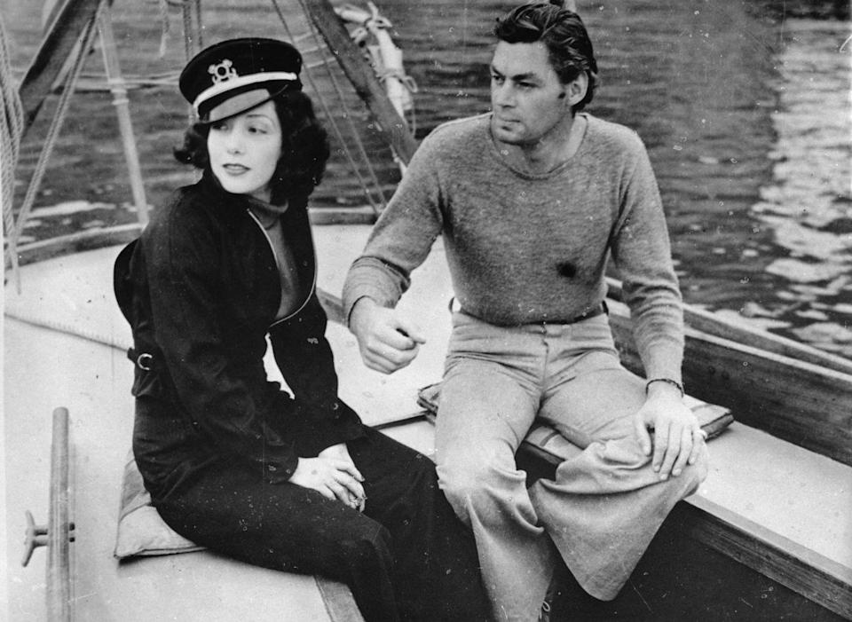 <p>Mexican-American actress Lupe Vélez joins her husband, <em>Tarzan </em>actor Johnny Weissmuller, on the bow of a sailboat. The look ready for a day on the sea, with Vélez wearing a navy sailor's cap atop her curls. </p>