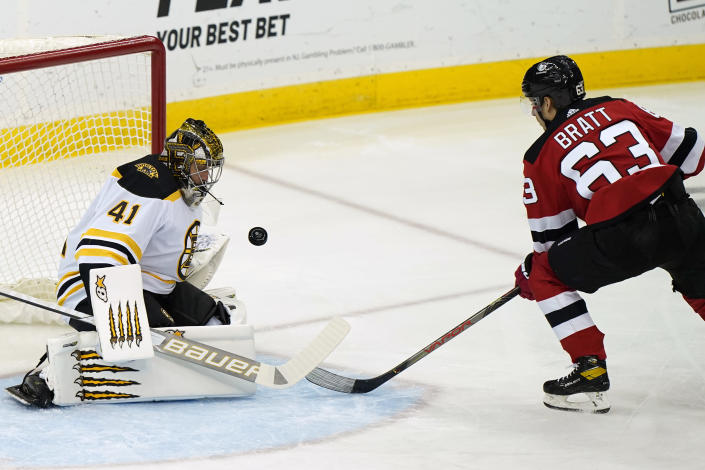 Boston Bruins goaltender Jaroslav Halak (41) makes a save on a shot by New Jersey Devils left wing Jesper Bratt (63) during the first period of an NHL hockey game, Tuesday, May 4, 2021, in Newark, N.J. (AP Photo/Kathy Willens)