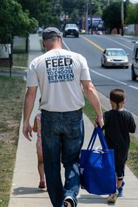 Faces of Hope campaign - Food Lion associate helps distribute food and hope to children in need