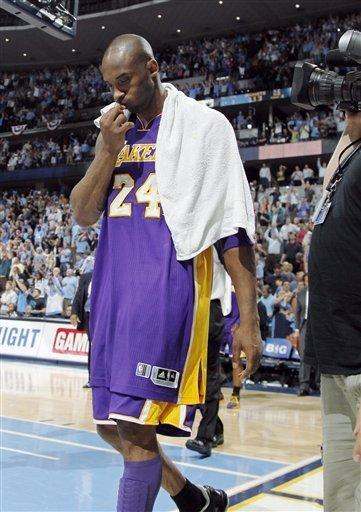 Los Angeles Lakers guard Kobe Bryant walks off the court after the Denver Nuggets' 113-96 victory in Game 6 of the teams' first-round NBA basketball series in Denver on Thursday, May 10, 2012. Bryant played with stomach flu. (AP Photo/David Zalubowski)