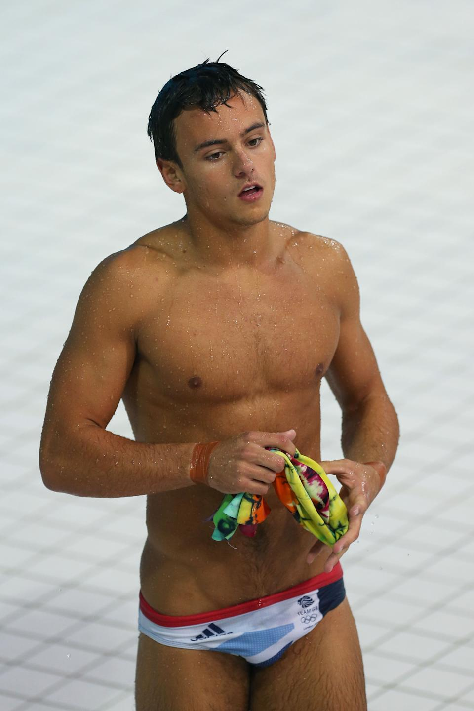 Much controversy has surrounded the British diver, Tom Daley, but one thing is indisputable his handsome face and sculpted body. (Photo by Clive Rose/Getty Images)