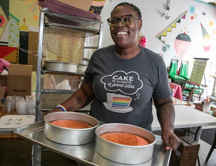 LGBTQ-owned bakery Good Cakes and Bakes Co-owner April Anderson with a Strawberry Crunch Cake at her shop on Livernois in Detroit on Aug. 11, 2020.
