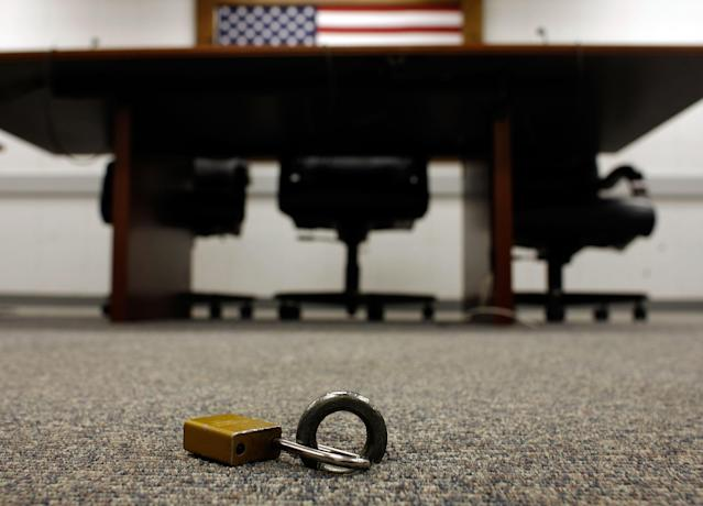 """GUANTANAMO BAY, CUBA - OCTOBER 03: IMAGE REVIEWED BY U.S. MILITARY PRIOR TO TRANSMISSION Detainees are padlocked to an eye-bolt in the floor when inside the Administrative Review Boards and Combatant Status Review Tribunals room inside the Camp Delta detention facility at the U.S. Naval Station at Guantanamo Bay October 3, 2007 in Guantanamo Bay, Cuba. Not technically a legal process, the tribunals """"provide an annual review to assess whether the detainees held at Guantanamo Bay present a threat to the U.S. or its allies,"""" according to the Office for the Administrative Review of the Detention of Enemy Combatants. Based on the tribunal's reccomendations, 199 detainees have been approved for release or transfer from Guantanamo. About 340 """"enemy combatants"""" captured since the September 11, 2001 attacks on the United States continue to be held on the island. (Photo by Chip Somodevilla/Getty Images)"""