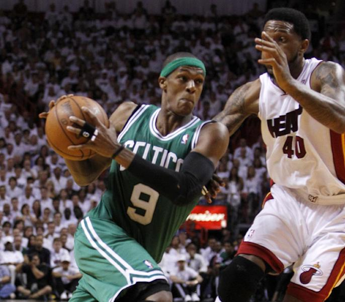 "FILE - In thbis June 9, 2012 file photo, Boston Celtics' Rajon Rondo (9) drives to the basket as Miami Heat's Udonis Haslem (40) defends during the second half of Game 7 of the NBA basketball playoffs Eastern Conference finals, in Miami. President Barack Obama is joining with NBA legend Michael Jordan and an array of basketball stars to raise money for his re-election campaign later this month. The Obama campaign is planning a fundraising ""shoot-around"" and dinner in New York on Aug. 22 featuring several NBA stars. (AP Photo/Lynne Sladky, File)"