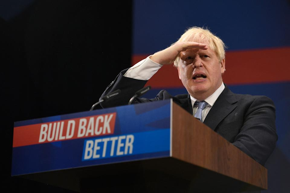 Britain's Prime Minister Boris Johnson delivers his keynote speech on the final day of the annual Conservative Party Conference at the Manchester Central convention centre in Manchester, northwest England, on October 6, 2021. (Photo by Oli SCARFF / AFP) (Photo by OLI SCARFF/AFP via Getty Images)