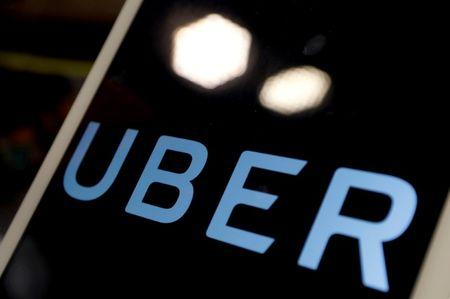 The logo of Uber is seen on an iPad, during a news conference to announce Uber resumes ride-hailing service, in Taipei, Taiwan April 13, 2017. REUTERS/Tyrone Siu/Files