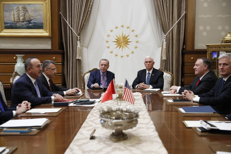 Vice President Mike Pence meets with Turkish President Recep Tayyip Erdogan at the Presidential Palace for talks on the Kurds and Syria, Thursday, Oct. 17, 2019, in Ankara, Turkey. Secretary of State Mike Pompeo and U.S. National Security Adviser Robert O'Brien, right, Turkish VP Fuat Oktay and Turkish Foreign Minister Mevlüt Çavuşoğlu, are left. (AP Photo/Jacquelyn Martin)