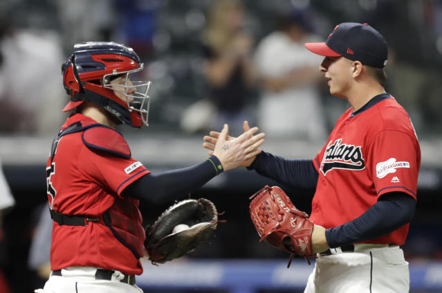 Cleveland Indians relief pitcher James Karinchak, right, is congratulated by catcher Roberto Perez after they defeated the Detroit Tigers in a baseball game, Thursday, Sept. 19, 2019, in Cleveland. (AP Photo/Tony Dejak)