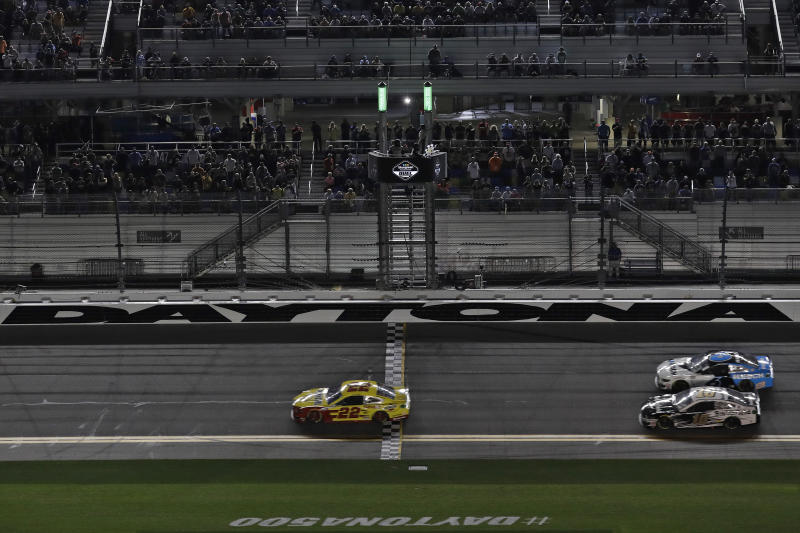 Joey Logano (22) beats Ryan Newman (6) and Aric Almirola (10) to the finish line to win the first of two NASCAR Daytona 500 qualifying auto races Thursday, Feb. 13, 2020, at Daytona International Speedway in Daytona Beach, Fla. (AP Photo/Chris O'Meara)