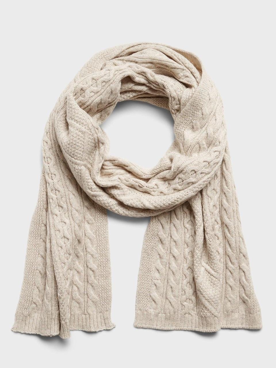 <p>And a matching <span>Banana Republic Cable-Knit Scarf</span> ($47) with...</p>