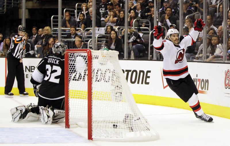 New Jersey Devils' Adam Henrique (14) reacts after scoring the game-winning goal against Los Angeles Kings goalie Jonathan Quick (32) in the third period during Game 4 of the NHL hockey Stanley Cup finals, Wednesday, June 6, 2012, in Los Angeles. The Devils won the game 3-1. (AP Photo/Julie Jacobson)