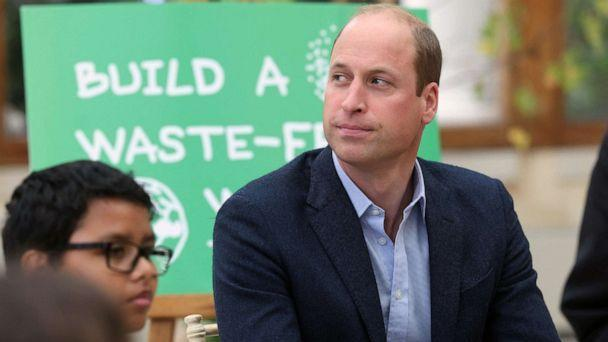 PHOTO: Britain's Prince William, Duke of Cambridge interacts with children from The Heathlands School, Hounslow during a visit at Kew Gardens, London, Oct. 13, 2021. (Ian VoglerAFP via Getty Images)