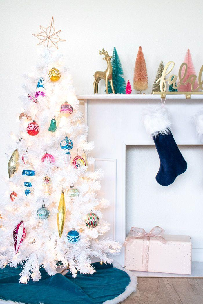 """<p>Colorful ornaments will really make a statement when set against a full-on white fir. Wrap it with string lights to give everything a subtle glow. </p><p><em><a href=""""https://www.clubcrafted.com/colorful-vintage-christmas-tree/"""" rel=""""nofollow noopener"""" target=""""_blank"""" data-ylk=""""slk:Get the tutorial at Club Crafted »"""" class=""""link rapid-noclick-resp"""">Get the tutorial at Club Crafted »</a></em></p><p><strong>RELATED:</strong> <a href=""""https://www.goodhousekeeping.com/holidays/christmas-ideas/g28998983/vintage-christmas-decorations-ornaments/"""" rel=""""nofollow noopener"""" target=""""_blank"""" data-ylk=""""slk:Best Vintage Christmas Decorations to Buy in 2020"""" class=""""link rapid-noclick-resp"""">Best Vintage Christmas Decorations to Buy in 2020 </a></p>"""