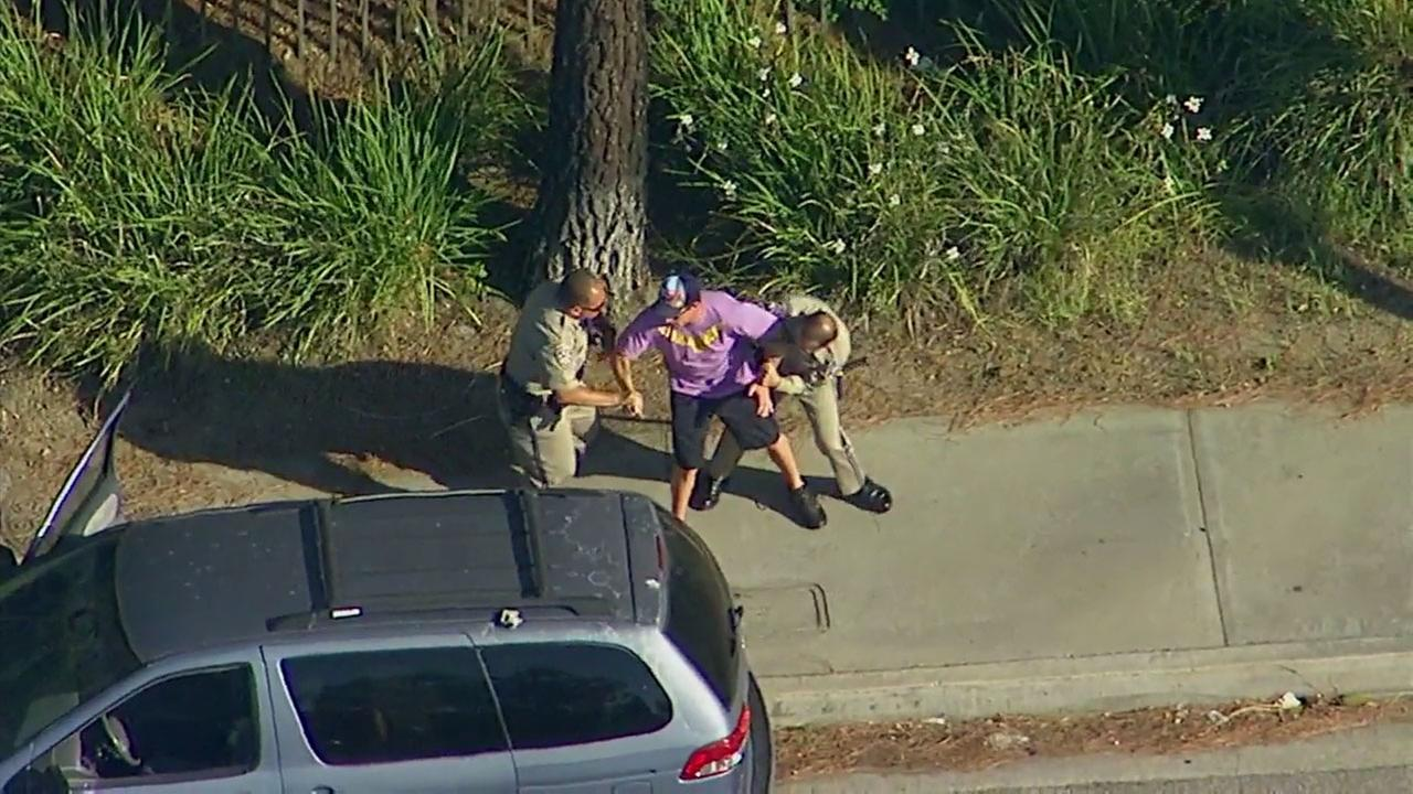 CHP officers engaged in a violent takedown of a man who was apparently fighting with a woman in a car as they drove in Burbank.
