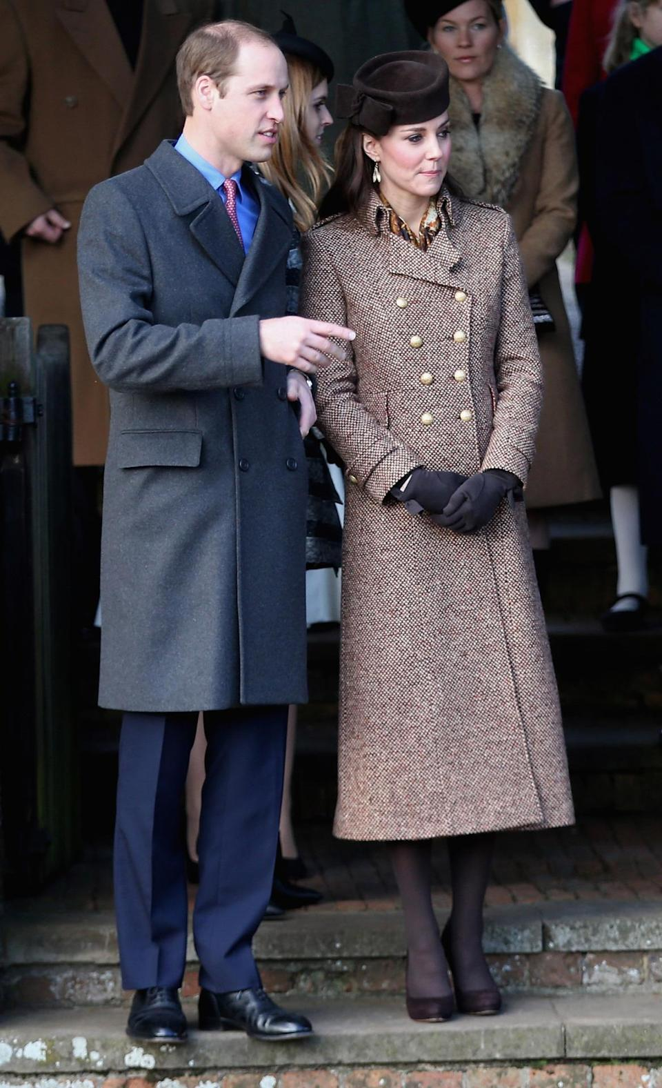 <p>Kate went for a sophisticated look for Christmas 2014. Wearing a brown tweed coat by Moloh, she accessorised with a matching Lock & Co hat, a printed silk scarf and brown heels by Emmy London.</p><p><i>[Photo: Getty]</i></p>