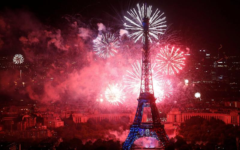 Fireworks explode in the sky around the Eiffel Tower, at the end of Bastille Day events in Paris on July 14, 2018 - REUTERS