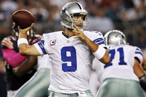 Dallas Cowboys quarterback Tony Romo (9) passes the ball against the Chicago Bears during the first half of an NFL football game, Monday, Oct. 1, 2012, in Arlington, Texas. (AP Photo/Tony Gutierrez)
