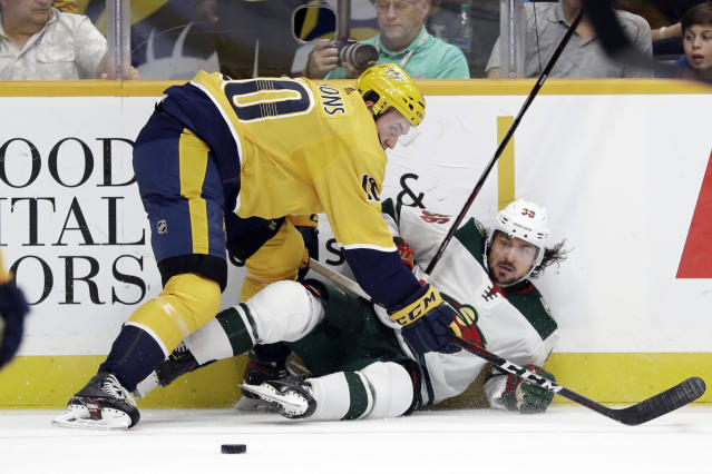 Nashville Predators center Colton Sissons (10) checks Minnesota Wild right wing Mats Zuccarello (36), of Norway, during the first period of an NHL hockey game Thursday, Oct. 3, 2019, in Nashville, Tenn. (AP Photo/Mark Humphrey)